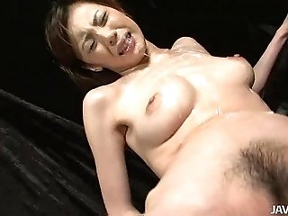 Slutty Natsumi lies down spreads her legs and is toyed