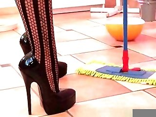 SEXY LADY CLEANS THE FLOOR IN HIGH HEELS  FASHION CATSUIT